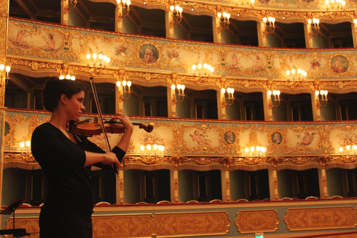 A violin student performs in one of Italy's most prestigious concert halls
